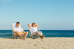 Woman and man relaxing on beach Royalty Free Stock Photography