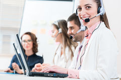 Woman and men working as call center agents royalty free stock images