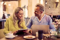 Woman and man working in cafe Stock Photos