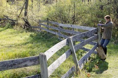 Woman mending fence. On rural property Royalty Free Stock Images