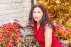 Woman in menopause in garden Stock Image