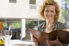 Woman with a menu Royalty Free Stock Photo