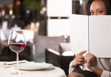 Woman with a Menu. Royalty Free Stock Images