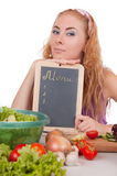 Woman with menu board and vegetables Royalty Free Stock Image