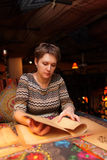 Woman with menu at table Royalty Free Stock Photography