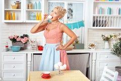 Woman with meringue. Stock Photos