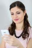 Woman messaging on mobile phone Royalty Free Stock Photos