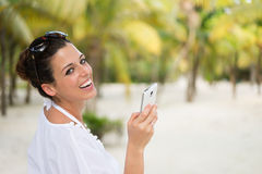 Woman messaging on smartphone during caribbean travel vacation Royalty Free Stock Image