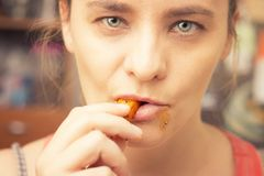 Woman messily eating french fries Royalty Free Stock Images