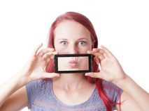 Woman messing around with camera phone Royalty Free Stock Photos