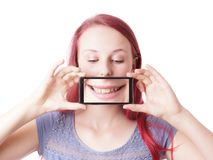 Woman messing around with camera phone Royalty Free Stock Images