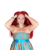 Woman messing with red hair. Royalty Free Stock Photo