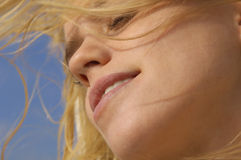Woman With Messy Blond Hair And Eyes Closed Stock Photo