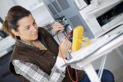 Free Woman Mesuring Voltage Machine Royalty Free Stock Images - 104027719