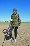 Woman with metal detector Stock Photography
