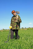 Woman with metal detector Royalty Free Stock Images