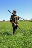 Woman with metal detector Stock Photo