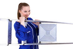 Woman with metal ladder Royalty Free Stock Photos