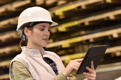 Woman metal worker using tablet Royalty Free Stock Images