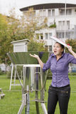 Woman meteorologist expects rain. Young woman meteorologist expects rain whilst inspecting instruments stock images