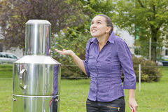 Woman meteorologist expects rain. Young woman meteorologist expects rain whilst inspecting instruments royalty free stock photos