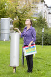 Woman meteorologist expects rain. Young woman meteorologist expects rain whilst inspecting instruments stock image