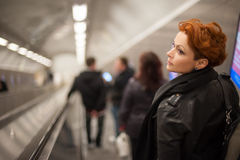 Woman in the metro escalator tounel Royalty Free Stock Photos