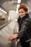 Woman in the metro escalator tunnel Royalty Free Stock Photos