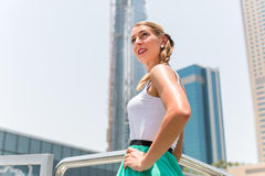 Woman in metropolitan city Dubai Royalty Free Stock Photography