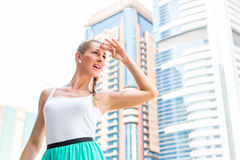 Woman in metropolitan city Dubai Royalty Free Stock Photo