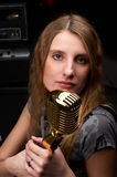 Woman with microphone. Woman with gold microphone look at center stock images