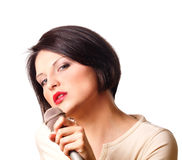 Woman with microphone Royalty Free Stock Image