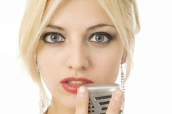 Woman and microphone Royalty Free Stock Images