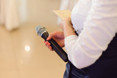 Woman with Microphone Stock Image