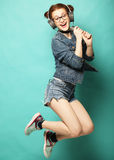 Woman with microphone jump in the air Stock Photography