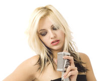 Woman and microphone looking to the side Royalty Free Stock Photo