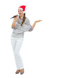 Woman with microphone presenting something Royalty Free Stock Image