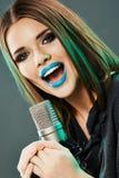 Woman microphone singing. Beauty model soun studio Stock Image