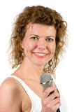 Woman with microphone on white Royalty Free Stock Photos