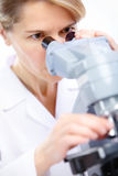 Woman with microscope Royalty Free Stock Photography
