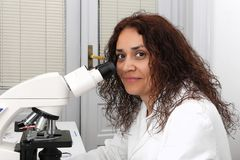 Woman with microscope Stock Photo