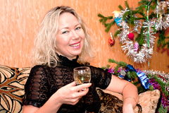 Woman middle-aged with glass. Beautiful charming woman middle-aged with glass of wine near a fir-tree Stock Photos