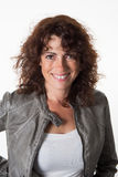 Woman, middle aged, with a green leather jacket Royalty Free Stock Images