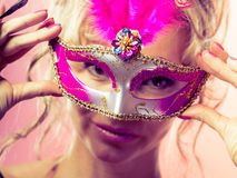 Woman middle aged holds carnival mask. Party time, holidays, people and celebration concept. Woman middle aged blonde female holds carnival mask. Lady wearing Royalty Free Stock Photos