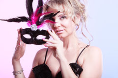 Woman middle aged holds carnival mask. Stock Images