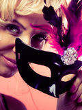 Woman middle aged holds carnival mask. Royalty Free Stock Photo