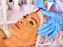 Woman middle-aged in spa salon with beautician Stock Photography