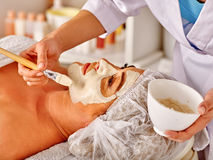 Woman middle-aged in spa salon with beautician Royalty Free Stock Images