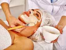 Woman middle-aged in spa salon with beautician Royalty Free Stock Photography