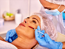 Woman middle-aged in spa salon with beautician Stock Photos
